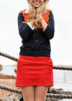 Navy cardi and the perfect bright orange-red skirt -- love it! // Classy Girls Wear Pearls