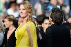 Uma Thurman in Atelier Versace gown at 2014 Cannes Film Festival.
