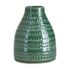 A small glazed ceramic vase in emerald green with a circle design.