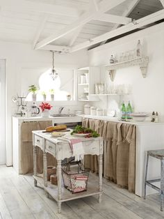 Creamy white-painted walls and whitewashed plywood floors (topped with three coats of polyurethane) make the small space feel more expansive.