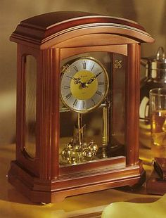 Bulova Nordale Table Clock. h1Bulova Nordale Table Clock_h1Bulova Nordale Table Clock. Solid Wood Case. Walnut Finish.Screened Glass Panels.Revolving Pendulum.. See More Table Clocks at http://www.ourgreatshop.com/Table-Clocks-C1125.aspx