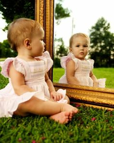 Magic mirror, on the grass,who's the cutest of this photo? Clearly the baby!! haha :)