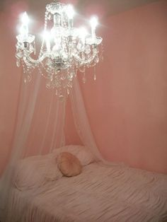 chandelier in the bedroom. Amazing.