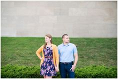 Engagement pictures downtown Kansas City at Liberty Memorial with floral dress…
