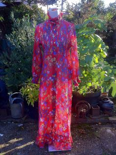 A personal favorite from my Etsy shop https://www.etsy.com/uk/listing/247914642/1970s-floaty-red-floral-maxi-house-coat
