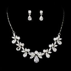"Silver Crystal Necklace Earring Bridal Jewelry Set Unique and radiant, this silver plated necklace and earring set features a lovely arrangement of rhinestones in various shapes and sizes. This is a versatile and beautiful addition to your classic, modern, or vintage-inspired wedding or event. This necklace measures 14-1/2"" long with a 3"" extender and lobster claw clasp. Matching earrings measure 3/4"" long.   Set is an elegant piece for a bride, bridesmaid, prom or any special occasion"