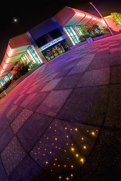 The floors in front of innovations at night at EPCOT - I'm putting this on my home design board because I think it would be awesome to have a starry light-up path to my front door :)