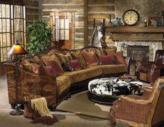 Paul Robert Furniture   rustic LR with leather/nailhead sofa, stone FP, timber lodge home flat log walls w chinking