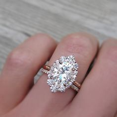 2.5 carat oval halo engagement ring paired with a conflict-free pavé wedding band $3800