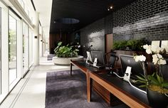 The black ceiling in this Sydney office creates a room within an otherwise larger space | The Fifth Wall