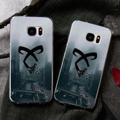 Shadowhunters Phone Case - Dark Rune This case is like a Glamour spell - just put in on, and your phone will instantly look so much cooler! And is protected against all kinds of accidents. (Not against demon attacks though. Please ask your local Institute for help and protection if one happens.)Fits most popular phones, looks great (even for mundanes) and keeps your phone safe. What are you waiting for? Order it today with free shipping!