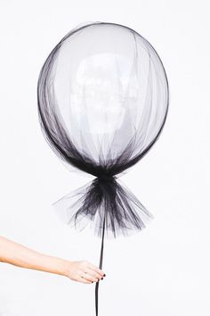 Black netting and helium balloons for Halloween