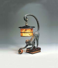 verdigris bronze patina monkey lamp, leather book design base, penshell shade