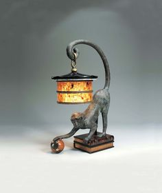 verdigris bronze patina monkey lamp, leather book design base, penshell shade