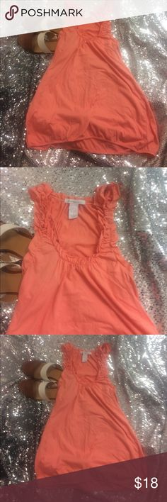 Charlotte Russe large peach top Great peach colored basic with feminine detailed ruffle at neckline. Very pretty and love the extra long length. In EUC from a smoke free home. Charlotte Russe Tops Camisoles