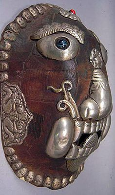 Kapala turtle shell mask  The Himalayan region  9.3 inches, turtle shell, silver ornamentation, semi-precious stones