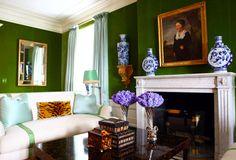 sofa, lumbar pillow in le tigre, fun mix of colors in tory burch's living room