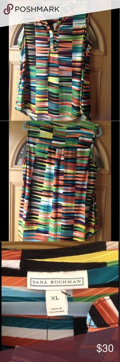 🍂🍂 Henley High-Low Sleeveless Top 🍂🍂 This many colored top is perfect for those fall days that are still HOT!  Beautiful material is stretchy and easy care. Pleating in back for a flown look. Spare gold button. Dana Buchman Tops Blouses