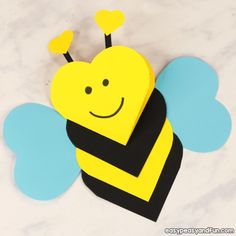 """This heart bee craft is both a craft and a super cute Valentines day card kids can easily make. You can make this craft to be """"true to"""" bee's colors or you can make it even more Valentinesy by changing… Continue Reading → Bee Crafts For Kids, Animal Crafts For Kids, Valentine Crafts For Kids, Toddler Crafts, Preschool Crafts, Arts And Crafts, Kids Diy, Craft Activities, Holiday Crafts"""