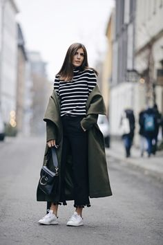 Clever details, such as breton stripes and tassels, make Valerie Husemann's outfit look effortless yet sharp.  Coat: Ivy&Oak, Sweater: Esprit, Shoes: Adidas, Bag: J. W. Anderson, Sunnies: Le Specs