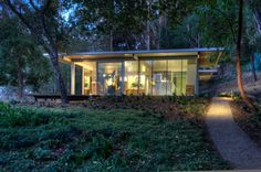 This 1200 sf customized itHouse is a guest house, office and private gym. The house is situated on a beautiful oak covered slope to take maximum advantage of the view to the east, with sliding doors giving direct access to a wood deck.    Built by Canyon Construction.  Designed by Taalman Koch Architecture.  Photographed by Treve Johnson.