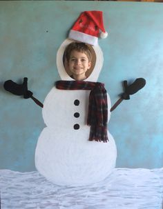 """Photo Booth Snowman for Community Country Christmas at Elementary School. Made from 1/4"""" mdf plywood, holes drilled and zip-ties used to hold hat, scarf and mitts in place."""