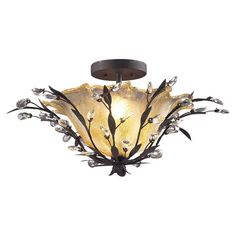 Bring eye-catching style to your entryway or dining room with this lovely semi-flush mount, showcasing crystal accents and a bronze finish.    ...