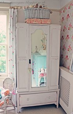 Shabby Chic vintage wardrobe with mirror in child's room