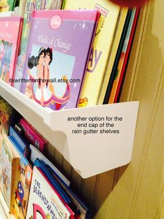 It's Written on the Wall: {Tutorial} What are Rain Gutter Book Shelves? Actual Rain Gutters Make Up a Library For the Kids