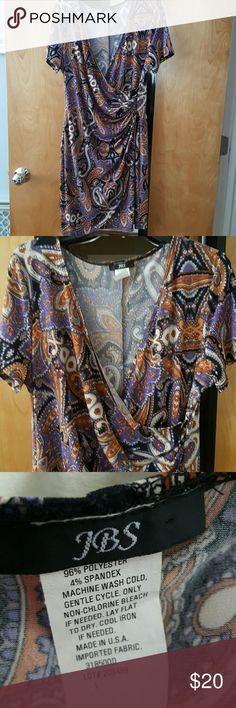 """Paisley Print Jersey Knit Dress Gorgeous jersey knit paisley dress.  Purple, orange, brown, black, white.  Goes with heels or boots & tights. Faux wrap skirt at ruching on waist.  Great condition, gently worn.  A closet favorite.  Lie flat measurements: Length from shoulder is 37"""" Length from waist is 21 1/2""""  Arm pit to arm pit is 19"""" Waist is 16 1/2""""  No trades.  Reasonable offers will be considered! jbs Dresses"""