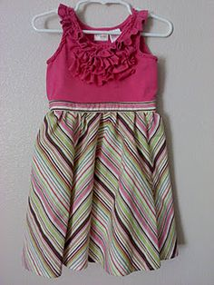 Repurpose a child's shirt that is too small with an old skirt of your own into a cutesy dress for a little girl!!!