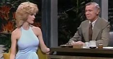 """If you've seen the classic film Blazing Saddles then you know who Robyn Hilton is. This photo of her talking with Johnny Carson on the Tonight Show way back in 1974 is when many say the term """"blonde bombshell"""" was first used. Johnny Carson, Here's Johnny, Robyn Hilton, Famous Murders, Rare Historical Photos, Jimmy Buffett, Tonight Show, Female Stars, Boris Johnson"""