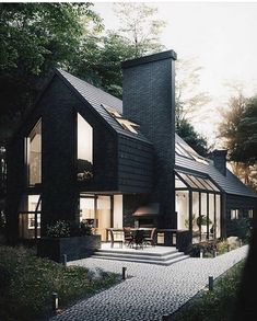 Barn house style black tile cladded residence with skylights and large windows