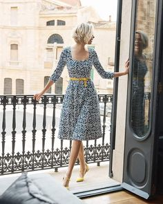 Patterned midi dress with yellow belt and shoes accent