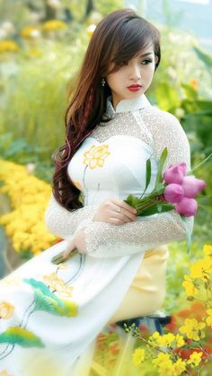 Stunninig young lady in a Vietnamese long dress