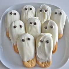 White Chocolate Ghost Cookies - made with Lorna Doone cookies, dipped in white chocolate. Add 2 mini chocolate chips for the eyes.
