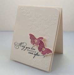 lovely card...luv how the cloud of embossed butterflies finish off the sentiment..