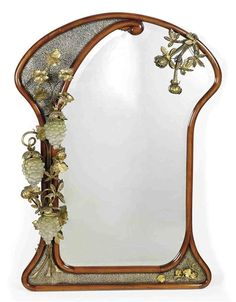 Joan Busquets i Jané (1874-1949) - Illuminated Wall Mirror. Carved Mahogany, Gilt Metal, Mould-Blown Glass, Frosted Glass Shades and Mirrored Glass. Barcelona, Spain. Circa 1908. 138.5cm x 100cm.