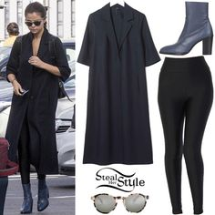 Selena Gomez was spotted arriving at Heathrow Airport in London yesterday wearing a Tailored Duster Coat by Boutique ($270.00), American Apparel Nylon Tricot High-Waist Leggings ($42.00), Enia Barcelona WLA Africa07 Sunglasses (Sold Out) and a pair of Topshop Magnificent Sock Boots ($150.00).