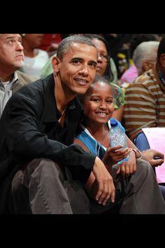 President Obama with daughter Sasha.