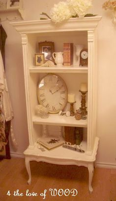 Frightening to French book shelf - a great re-purposing project of attaching an old dresser to an old coffee table, adding some decorative trim and molding, and painting.