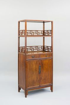 A Huanghuali Wood Book Cabinet, Qing Dynasty, late 17th Century