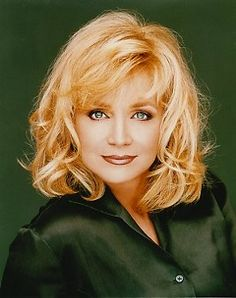 Barbara Mandrell.  Don't know her but I would like to.  I believe she is a good woman.  She has been the victim of judgement.  None of us have that right.  If lovin her is wrong, I don't wanna be right.  She is great.