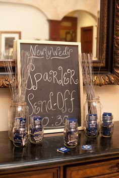 Frame sparkler sign, place sparklers in large mason jars with gold ribbon & custom matches in small mason jars.