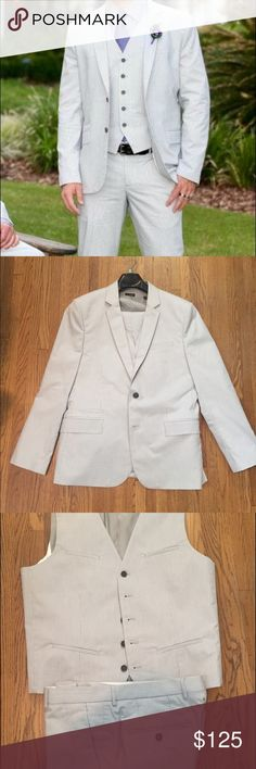 """Express Fitted Pinstriped 3 Piece Suite Express Fitted 3 Piece Suit. Pants are 32"""" waist.  Jacket is 44R. Worn one time in wedding. Gray pinstripe. Excellent condition. Express Suits & Blazers Suits"""
