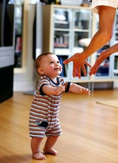 standing with assistance in the 7 month.