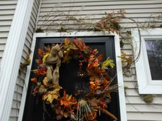 Pick from your yard for decorating over the front door.