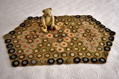Antique 19th century Hand Stitched Penny Rug on Burlap.    Sold  Ebay   383.00