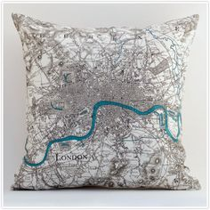 Vintage London on a pillow... cool for an adult room, but inspired me to imagine colourful map pillows in a child's room