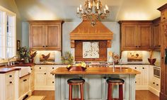 I love the wood cabinets mixed with the white cabinet. Makes me think of beautiful and comfortable at the same time.